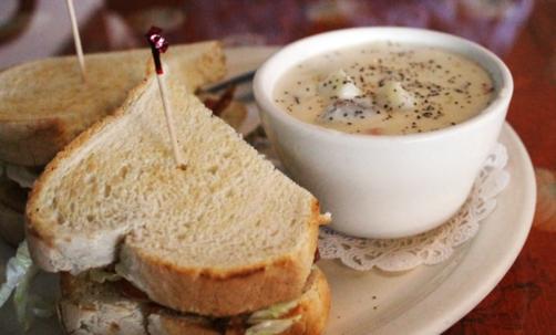 BLT with a cup of potato soup.
